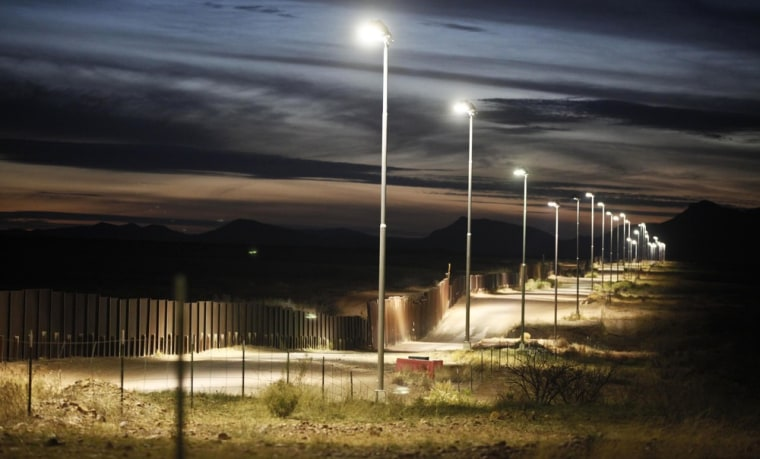The feds have already build 670 miles of fence on the border, like this one near Naco, Ariz. A deal in the Senate calls for the completion of 700 more miles.