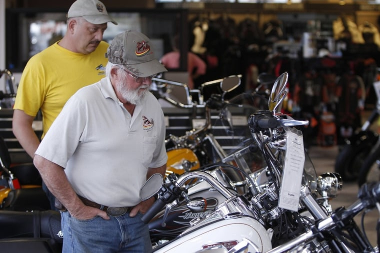 Customers look at the showroom inventory at Harley-Davidson of Frederick in Frederick Maryland in this October 23, 2012 file photo.
