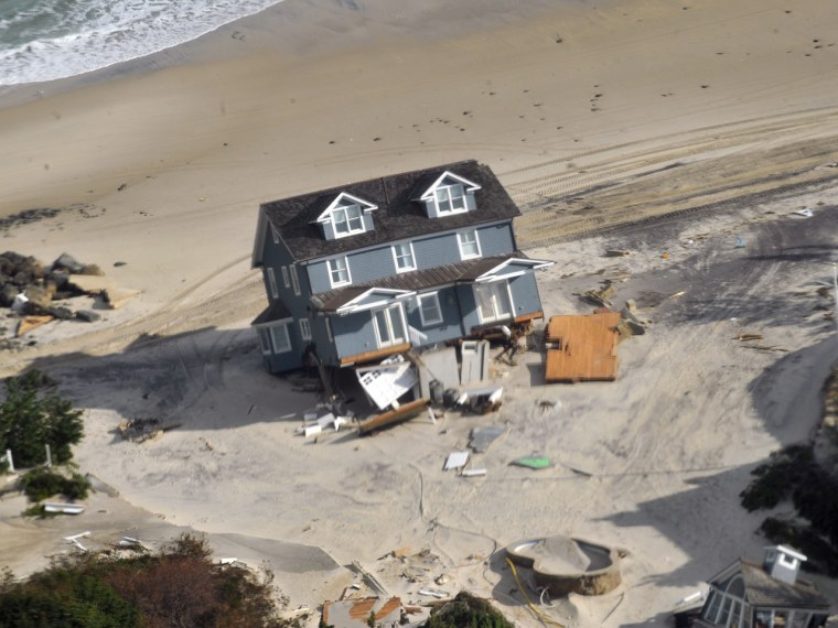 A damaged house is shown in this U.S. Army National Guard aerial photograph taken over the Jersey Shore seen during a visit by National Guard senior l...