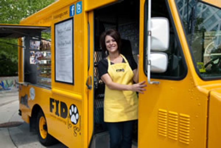 Donna Santucci poses in one of her Fido To Go trucks. Food trucks for pets are a growing business that owners say are reaping profits.