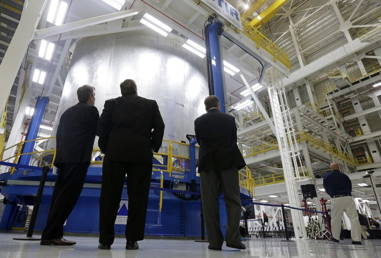 Executives check out the new vertical weld center at NASA's Michoud Assembly Facility in New Orleans, on Friday. NASA officials in New Orleans publicly unveiled the new, three-story-tall cylindrical structure that is a key component in constructing heavy-lift rockets for the nations' space program.