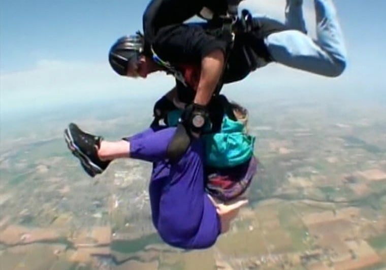 Laverne Everett's skydiving partner holds onto her after she fell out of her harness.