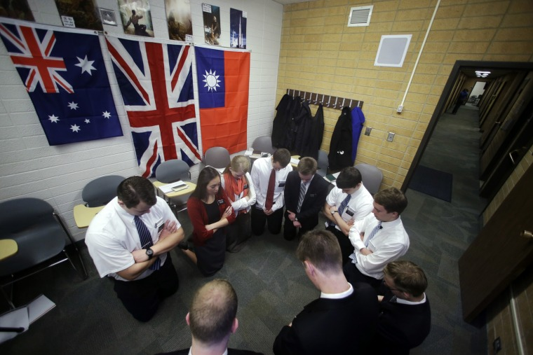 Mormon missionaries pray before the start of a class in Mandarin Chinese language at the Missionary Training Center, in Provo, Utah, on Jan. 8, 2013. ...