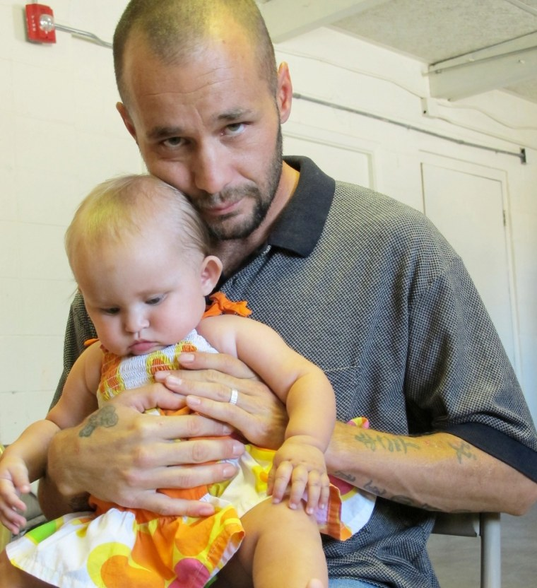 This June 20, 2013 image shows David Hutchinson and his daughter Navaeh posing for a photograph at Joy Junction homeless shelter in Albuquerque, N.M.