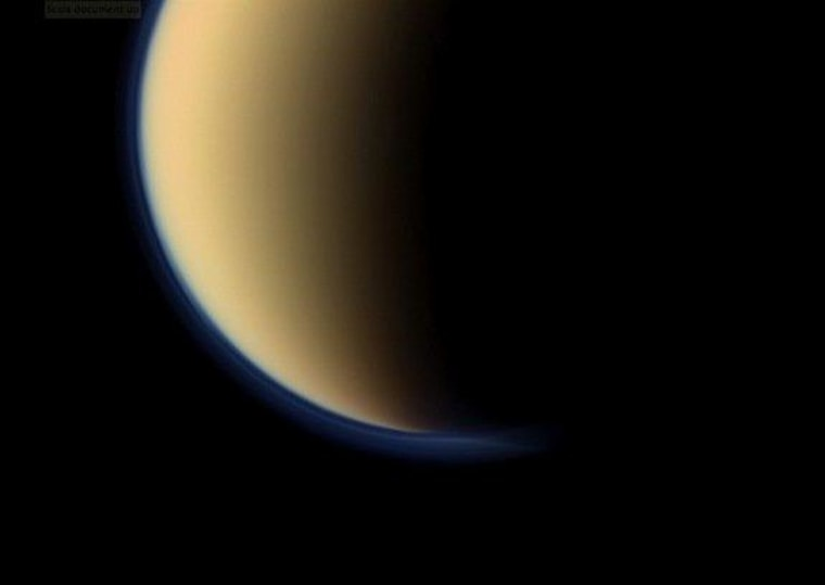 This view shows a close-up of toward the south polar region of Saturn's largest moon, Titan, and shows a depression within the moon's orange and blue haze layers near the south pole. NASA's Cassini spacecraft snapped the image on Sept. 11, 2011.