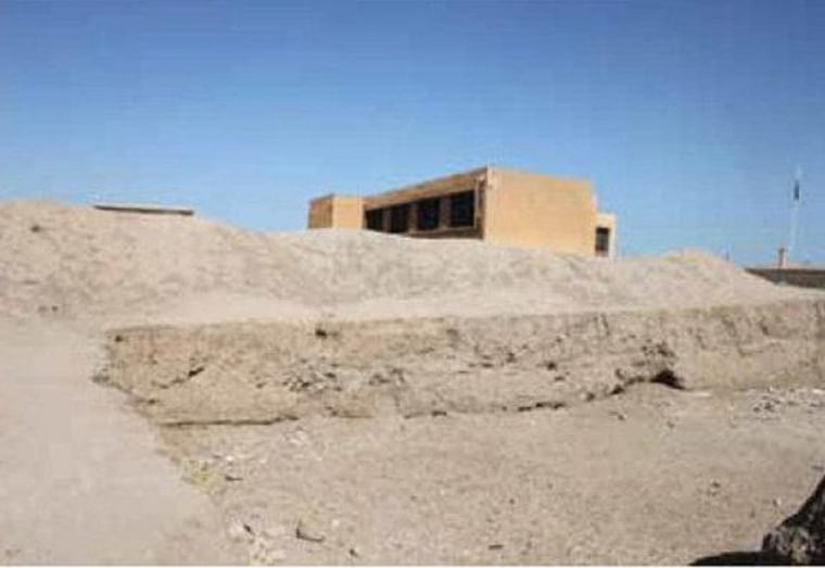 A bulldozer cut into part of the ancient city of Hamoukar by contractors building an addition to a school. Without protection at the site, modern-day buildings are being erected over it. Image taken in April 2012.