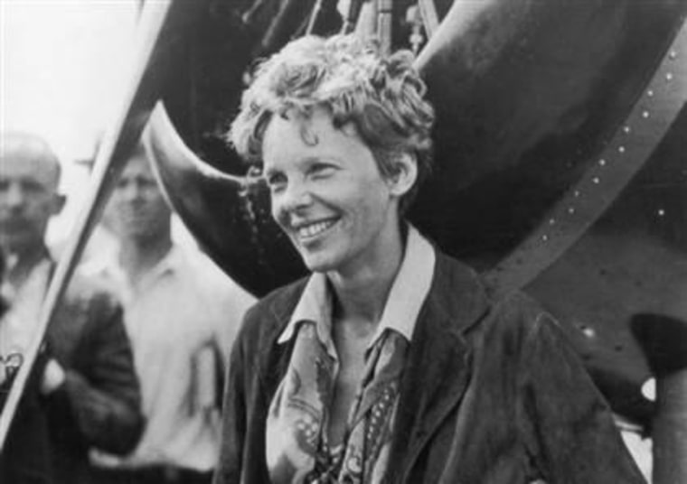Amelia Earhart exits her aircraft at Derry, Ireland, after her solo transatlantic flight in 1932.