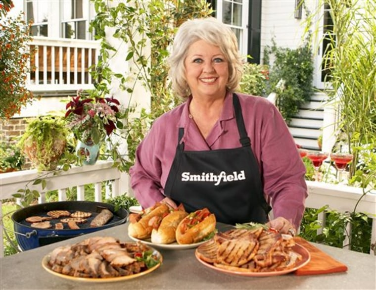 FILE - This undated image released by Smithfield Foods shows celebrity chef Paula Deen wearing a Smithfield apron as she stands in front of various Sm...