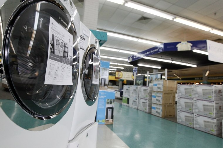 In this April 27, 2012 photo, washing machines and air conditioners line the aisles of a Cowboy Maloney's Electric City Superstore in Jackson, Miss.