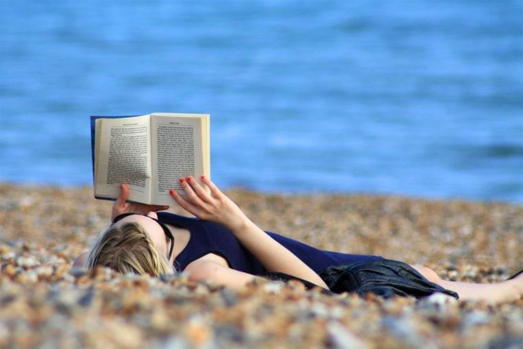 reading, summer, beach, woman, book, msnbc stock photography