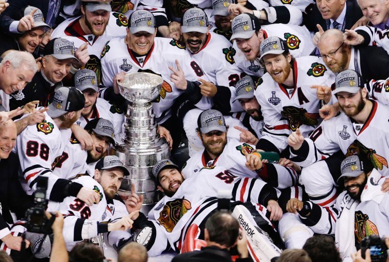 The Chicago Blackhawks pose with the Stanley Cup after beating the Boston Bruins 3-2 in Game 6 of the NHL hockey Stanley Cup Finals, on June 24, 2013, in Boston.