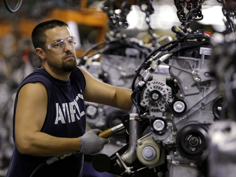 In this Aug. 26, 2009 photo, Chris Wasmer, of Kearney, Mo., works on an engine for a 2010 Ford Escape at Ford's Kansas City Assembly Plant in Claycomo...