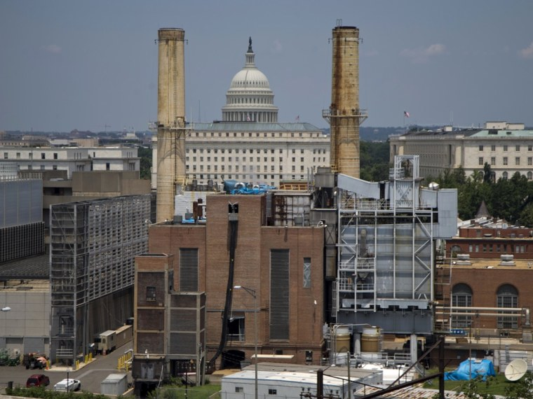 The Capitol Dome is seen behind the Capitol Power Plant in Washington, Monday, June 24, 2013. The plant provides power to buildings in the Capitol Complex. President Barack Obama is running out of time to make good on his lofty vow to confront climate change head-on, and Congress is in no mood to help.