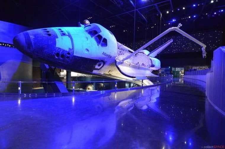 Bathed in simulated Earth-shine, space shuttle Atlantis comes to life in its new $100 million exhibit, opening Saturday at NASA's Kennedy Space Center Visitor Complex.