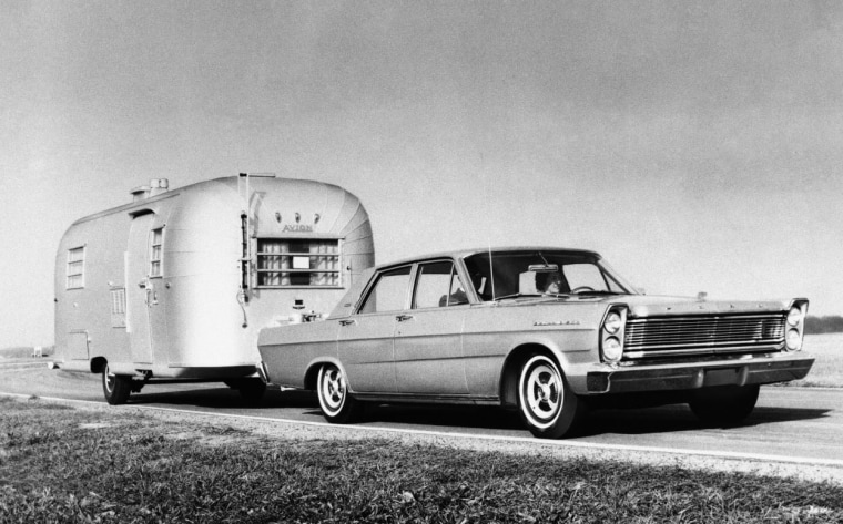 Ford Mustang with travel trailer.