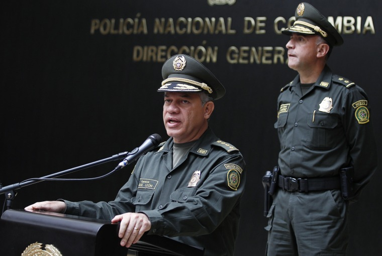 Colombia's National Police Chief Gen. Jose Roberto Leon Riano, left, talks to the media as Metropolitan Police Commander Gen. Luis Martinez looks on at police headquarters in Bogota on Tuesday. Leon said that four male gang members were arrested in connection with the murder of Special Agent James