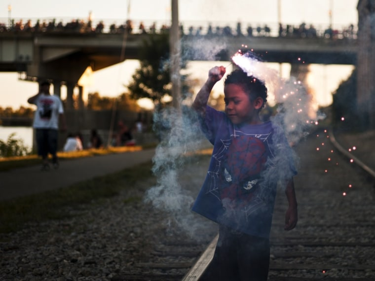 Marciano Young, 5, plays with a sparkler before the fireworks show in Saginaw, Mich., Monday evening July 4, 2011. The U.S. celebrated the 235th anni...