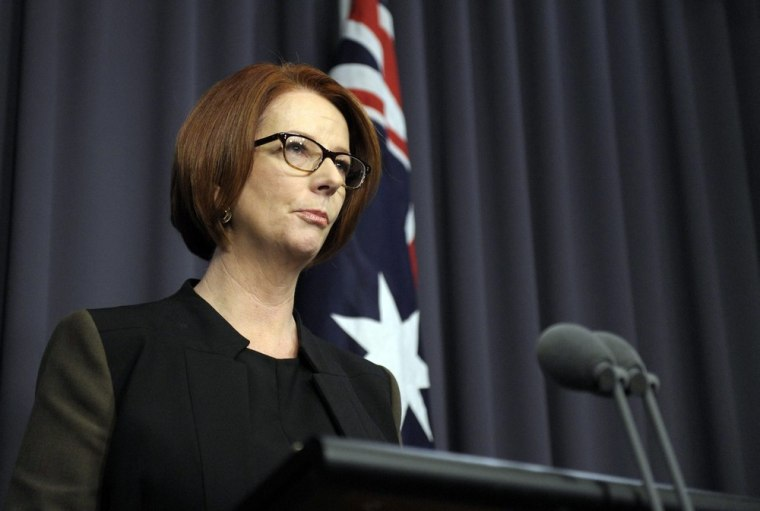 Outgoing Australian Prime Minister Julia Gillard announces her resignation after losing a leadership ballot to former premier and current Foreign Minister Kevin Rudd, Canberra, Wednesday.