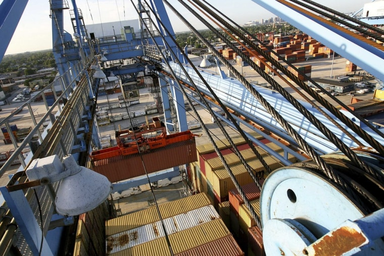 Crews load and unload consumer products at the Port of New Orleans along the Mississippi River in New Orleans, Louisiana in this file photo taken June...