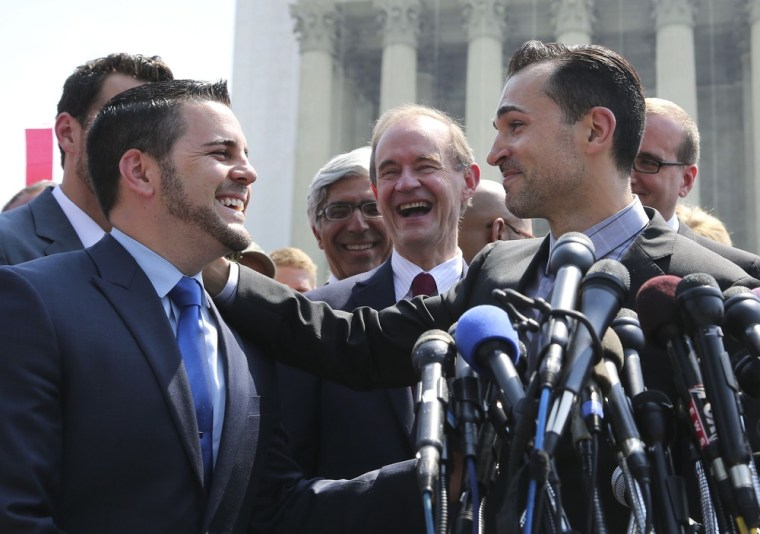 Paul Katami, right, proposes marriage to Jeff Zarrillo. The two were plaintiffs in the case against Proposition 8, the California ban on gay marriage.