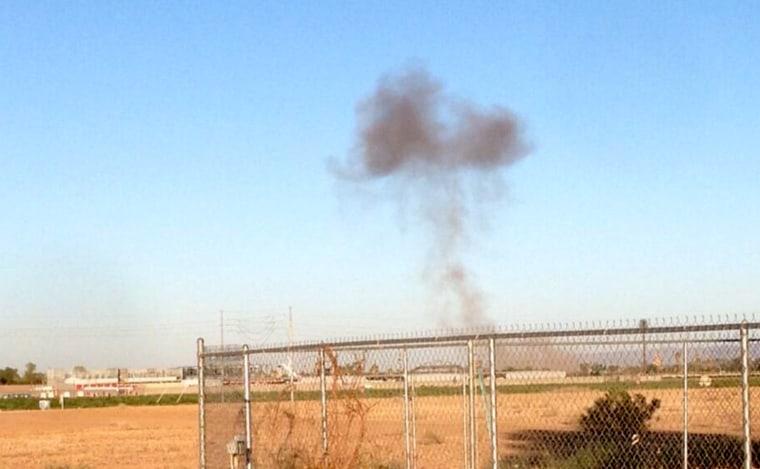 Smoke rises from the scene of an F16 fighter jet crash Wednesday, June 26, near Glendale, Ariz.