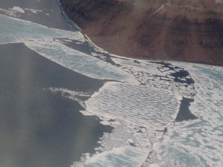 The ice breaking off from the mainland, where a group of campers were stranded in the Canadian arctic for almost two days.