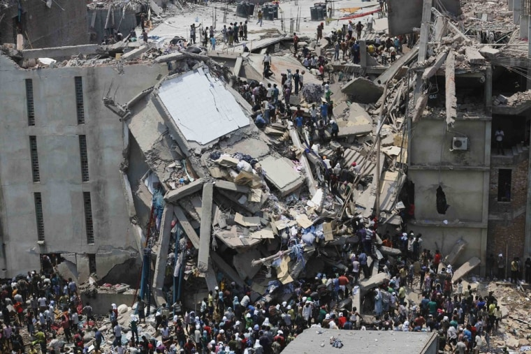 People rescue garment workers trapped under rubble at the Rana Plaza building after it collapsed, in Savar, 30 km (19 miles) outside Dhaka in this Apr...