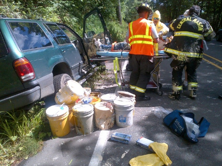 The driver is removed from his vehicle after the crash.