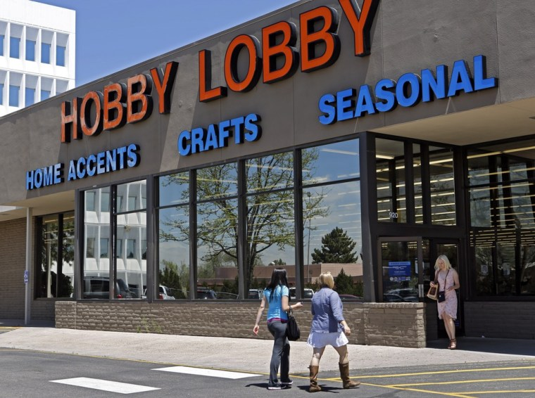 Customers a Hobby Lobby store in Denver in May. Lobby stores is challenging a federal mandate requiring it to offer employees health coverage that includes access to contraception.