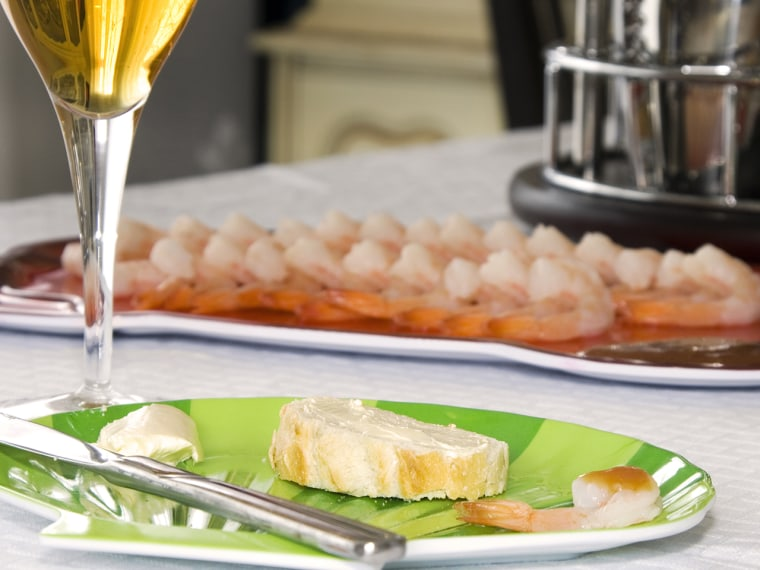 Close up on a sliced bread with blurred shrimps and Glass of Wine on the background