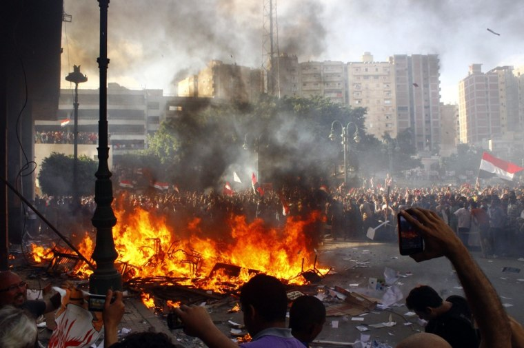 Opponents of Egyptian President Mohamed Morsi burn a Freedom and Justice Party office Friday in Alexandria, Egypt.