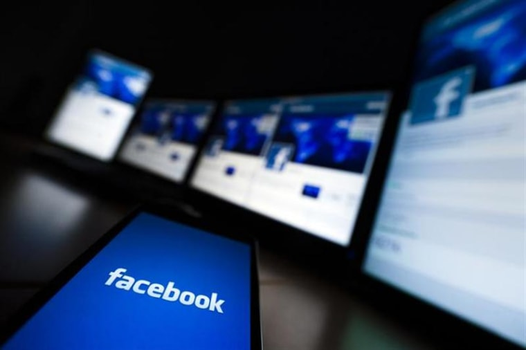 The loading screen of the Facebook application on a mobile phone is seen in this photo illustration taken in Lavigny May 16, 2012. REUTERS/Valentin Fl...
