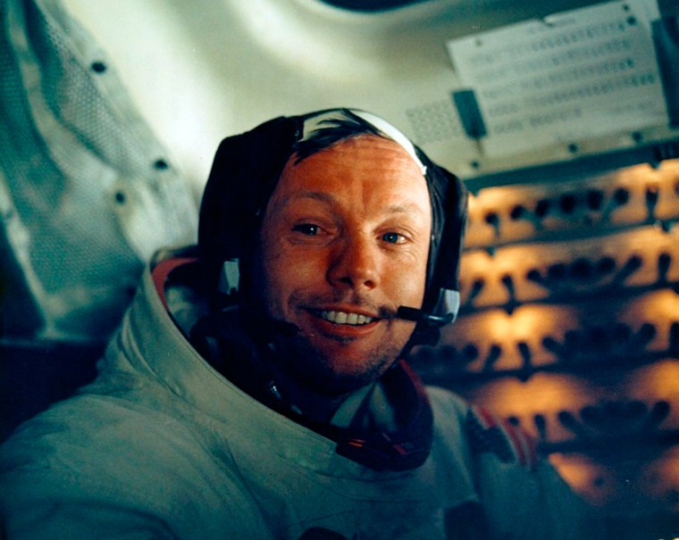 U.S. astronauts Neil Armstrong smiles in the lunar module after his historic moonwalk are pictured in this NASA handout photo.  Armstrong, has died at...