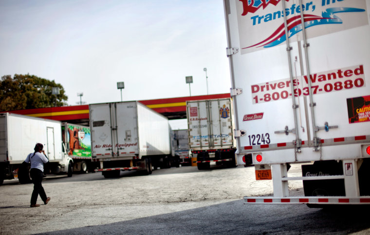 A sign on the back of a truck advertises job openings at a truck stop Tuesday, Oct. 30, 2012, in Atlanta. Even amid a struggling economy with high une...