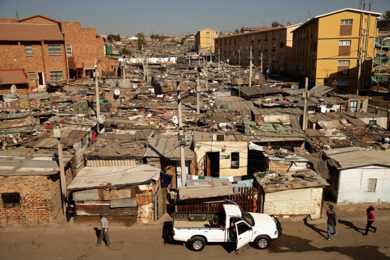 Built in a haphazard swath, shacks stretch on to the horizon in Alexandra Township on June 26, in Johannesburg, South Africa. Alexandra is situated next to the wealthy suburb of Sandton, laying bare post-apartheid South Africa's vast gulf between wealth and poverty.