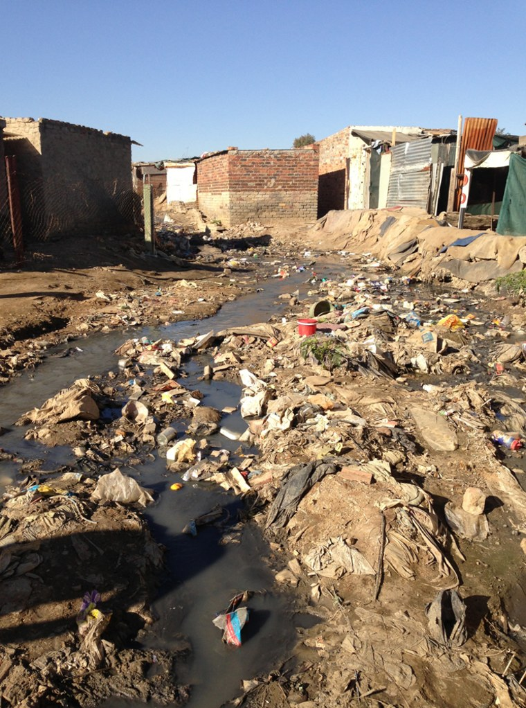 Streams of sewage and garbage run through the streets of Diepstloot, South Africa.