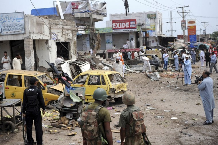 Pakistani security personnel are pictured at the site of a bomb attack in Badaber, on the outskirts of Peshawar, Sunday.