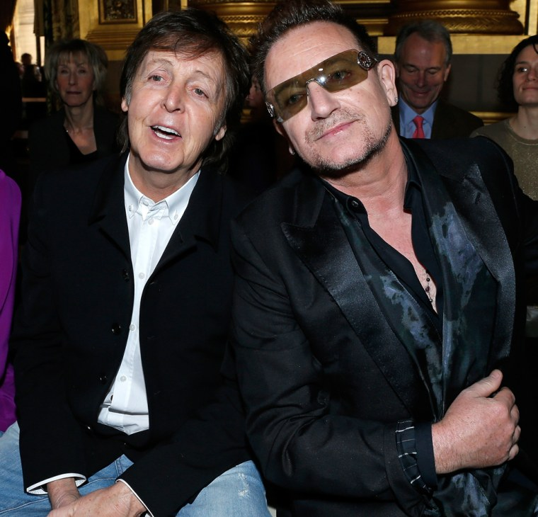 Paul McCartney, left, and Bono in Paris on Monday.