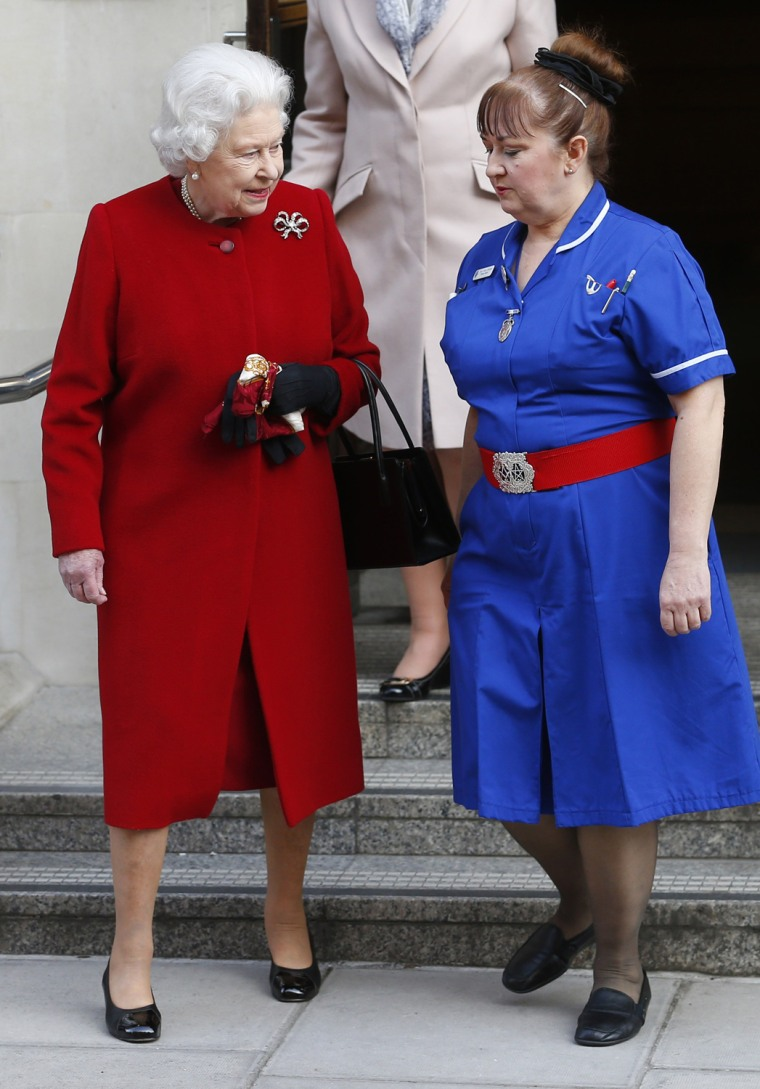 Nurse Anne Jenkins bids farewell to Britain's Queen Elizabeth as she leaves the King Edward VII hospital in London Monday.