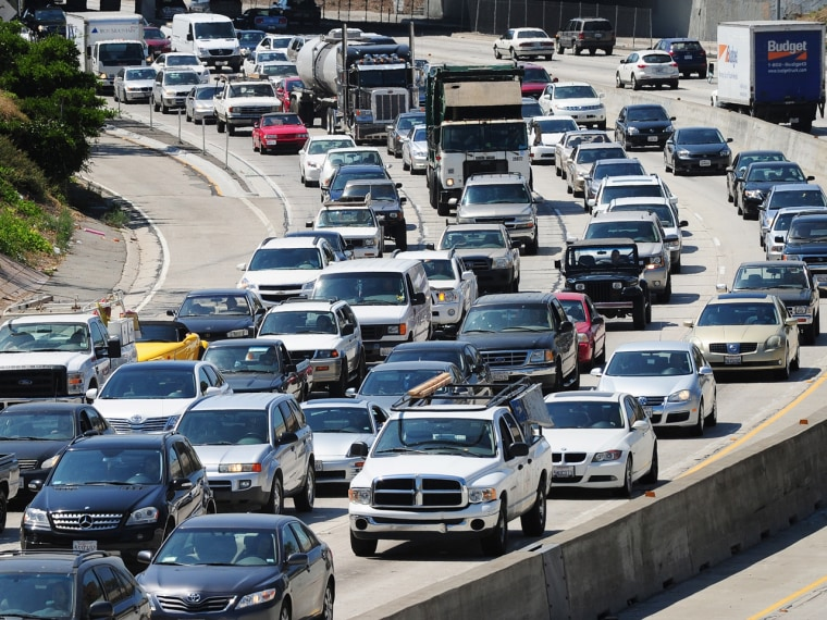 Commuters move slowly during heavy traffic on a freeway in Los Angeles in 2011. California is among the states with the highest percentage of people commuting an hour or more.