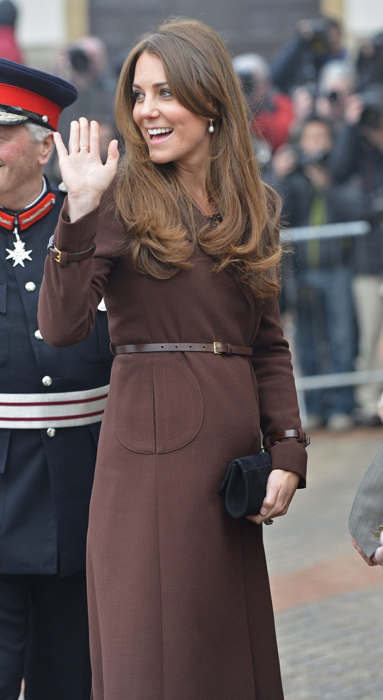 For the first time, a tiny baby bump is visible as Kate arrives in Grimsby, England.