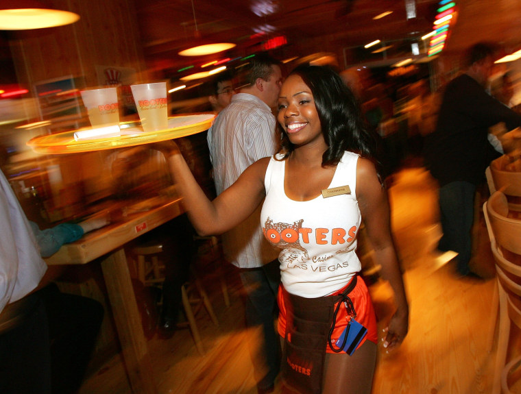 Charmaine Fobbs carries drinks at a  Hooters Restaurant on Feb. 2, 2006, during the grand opening of the Hooters Casino Hotel in Las Vegas.