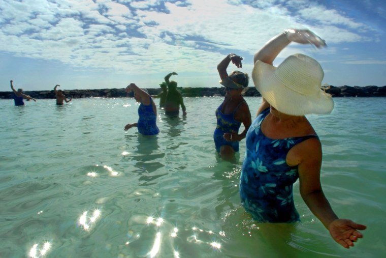 Seniors exercise in the waters of Waikiki Beach in Honolulu, Hawaii, a city known for its high housing costs.