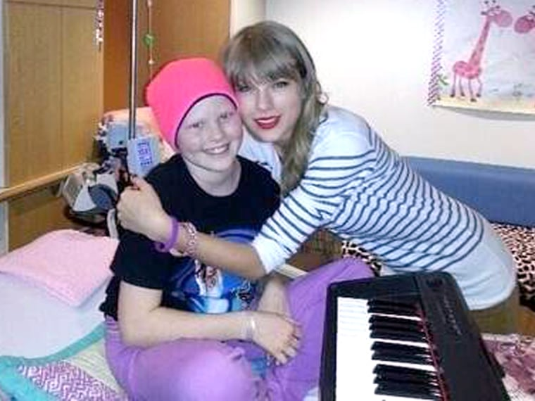 Taylor Swift visting with 10-year-old cancer patient Lauren Hacker.