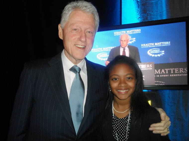 Haile poses with President Bill Clinton during the Clinton Foundation's Health Matters conference.
