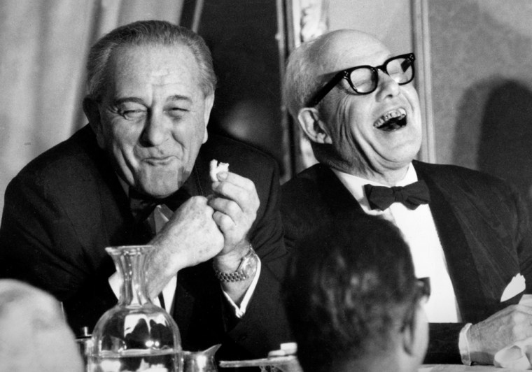 In this Nov. 9, 1967 file photo, U.S. President Lyndon B. Johnson and George Meany, president of AFL-CIO, laugh at a speaker's remark during the first annual Jewish Labor Committee Human Rights Awards dinner at the Sheraton in New York.
