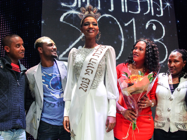 Yityish Aynaw, 21, stands with friends after being crowned Miss Israel  on Feb. 27.