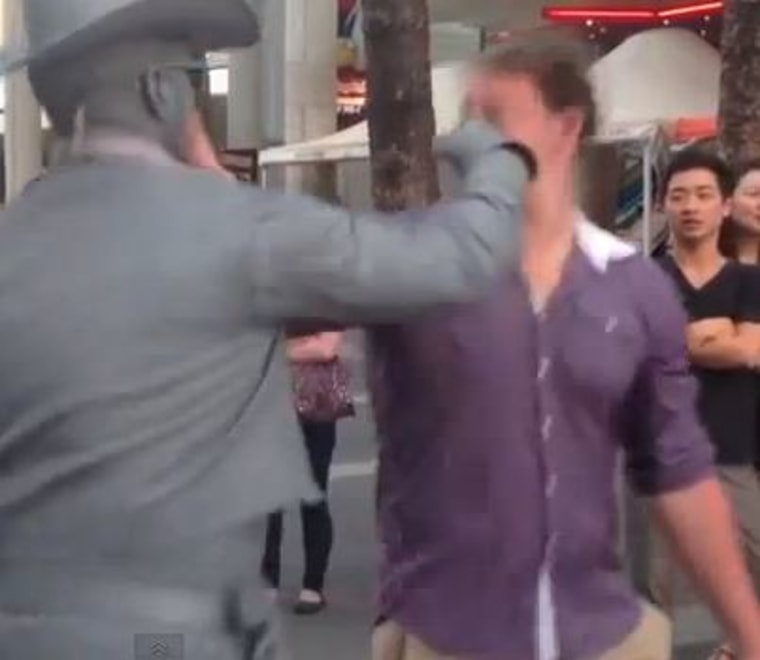 Cowboy punches heckler