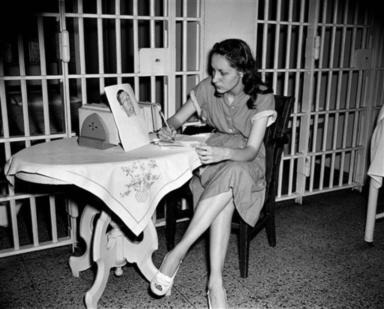 Ruth Steinhagen, then 19, writes notes for her life history in Cook County Jail in Chicago in this June 18, 1949 photo.