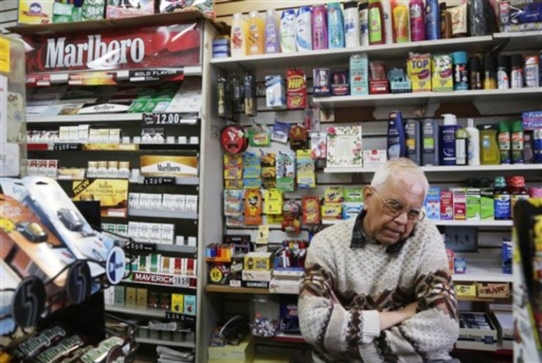 Harry Patel, an employee of Blondie's Deli and Grocery, talks on the phone while waiting for customers in New York on Monday. A new anti-smoking proposal would make New York the first city in the nation to keep tobacco products out of sight in retail stores. Mayor Michael Bloomberg says the goal is to reduce the youth smoking rate.